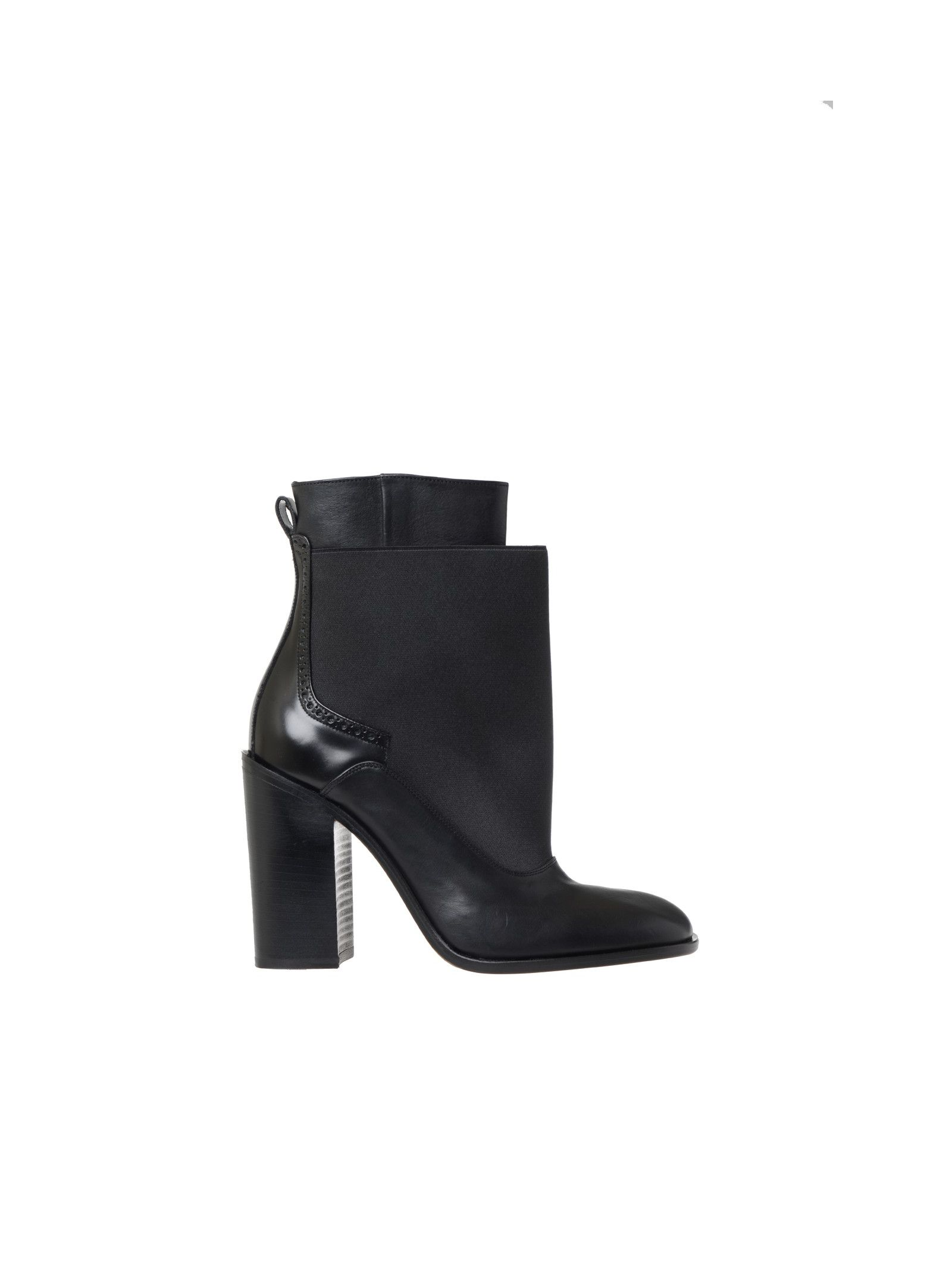 Ankle boots in pelle Sole: Real leather Details: Leather ankle boots, Tone-on-tone stretch fabric insert, Round toe, Brogue detail on the back, Closure on the inner side of the foot, Leather innersole