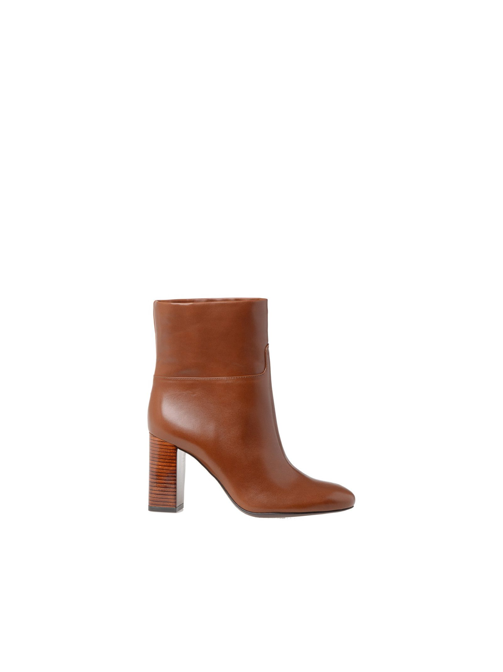 Leather boots Details: Leather upper, Leather interior, Chunky heel, Almond toe