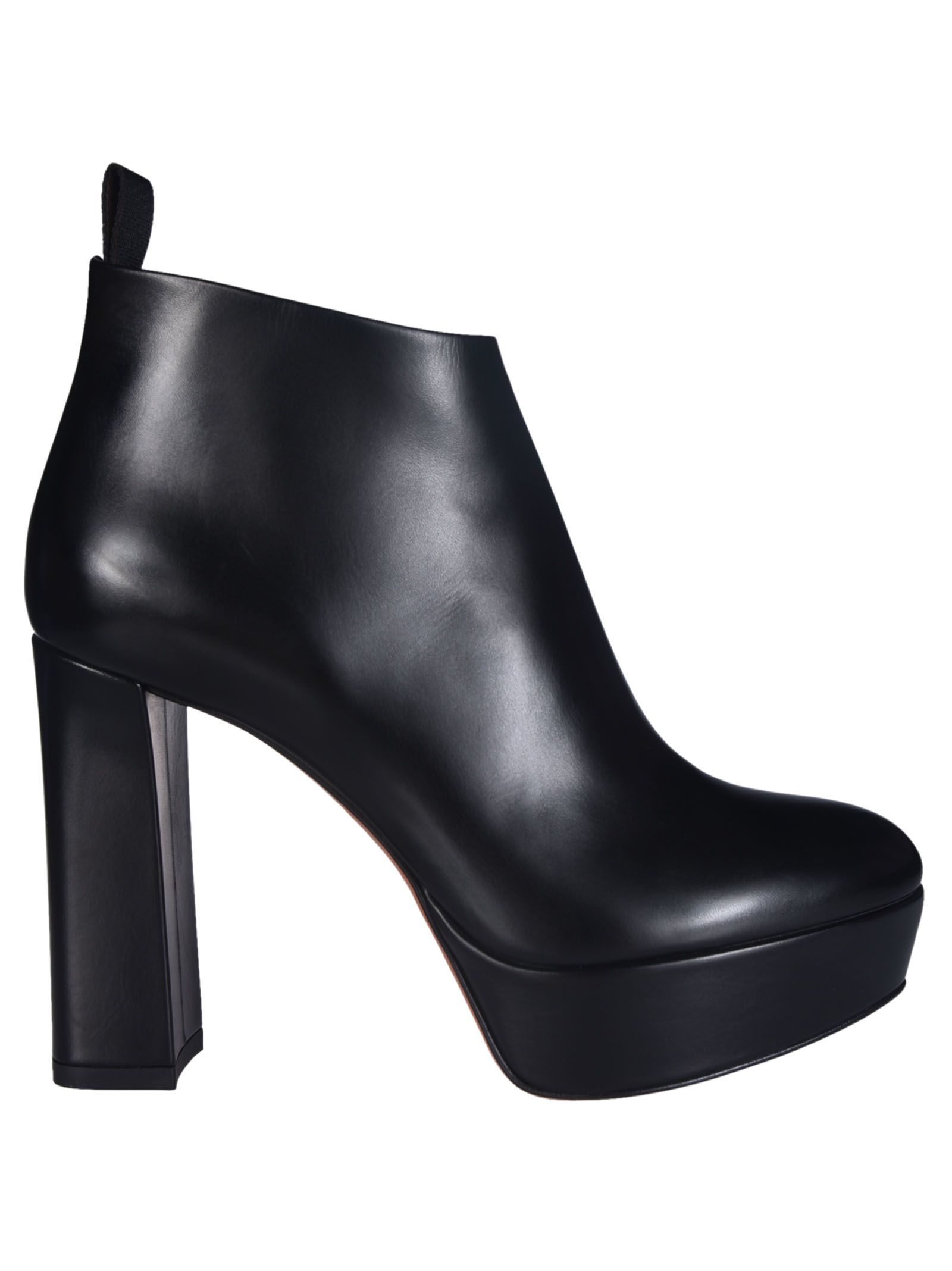 Platform Ankle Boots from Santoni: Black Platform Ankle Boots with a round toe, slip on, closed cupped heel, logo on sole.