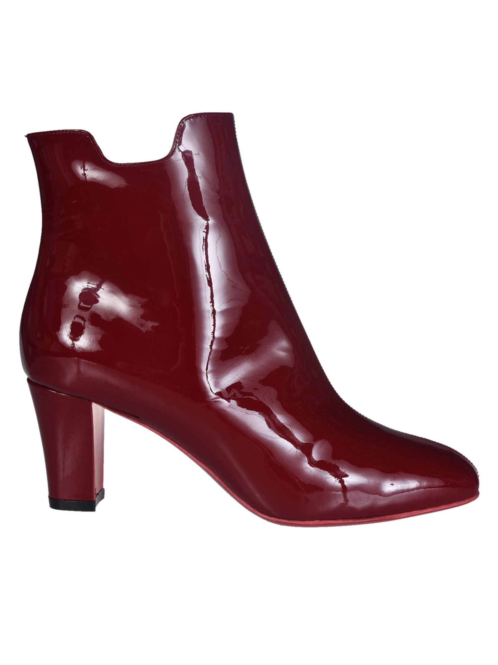 Block Heel Boots from Christian Louboutin: Red Block patent leather Heel Boots with side zip closure and signature red sole