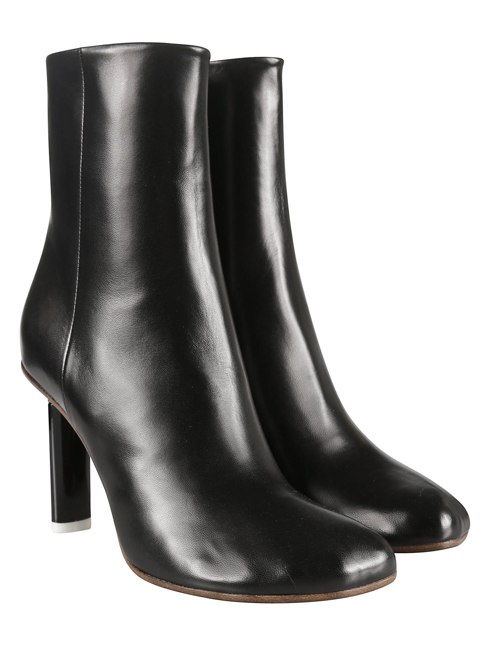 Leather Ankle Boots from VETEMENTS: Black Leather Ankle Boots with round toe, high heel and side zip fastening.