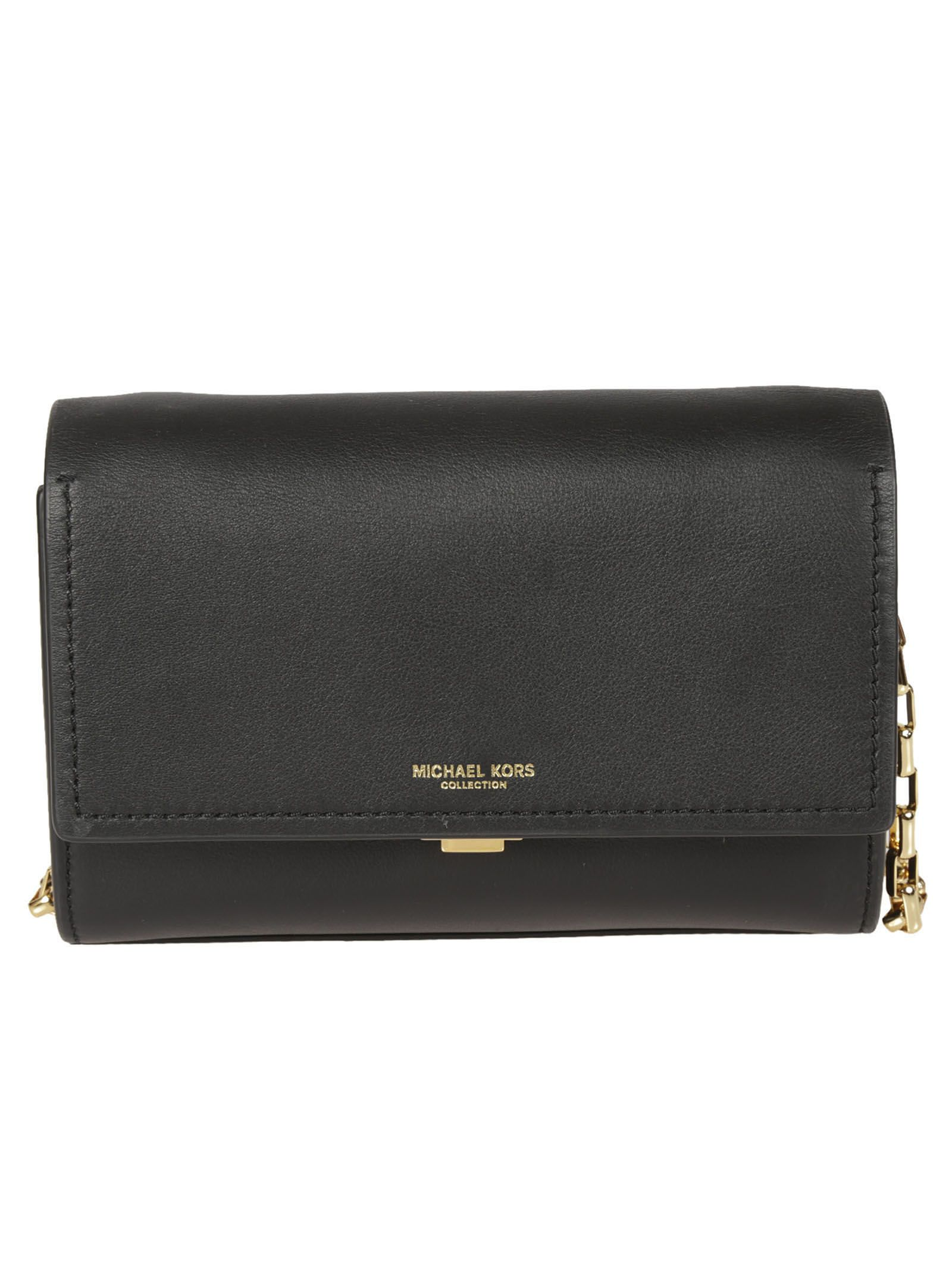 Small Yasmeen Clutch from Michael Kors: Black Small Yasmeen Clutch with flap closure, silver hardware, optional cross body chain strap, exterior, slip pocket, interior zip pocket and two card slots.