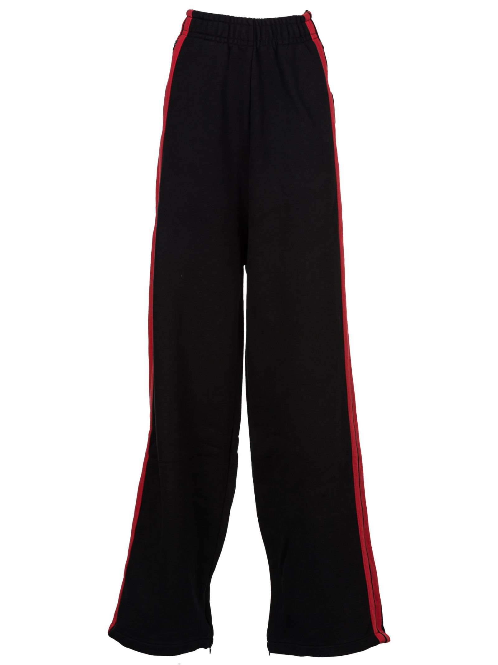 Black Oversized Lounge Pants by Vetements with elasticized waistband, jersey striping in red at side-seams and zippered vent at cuffs.