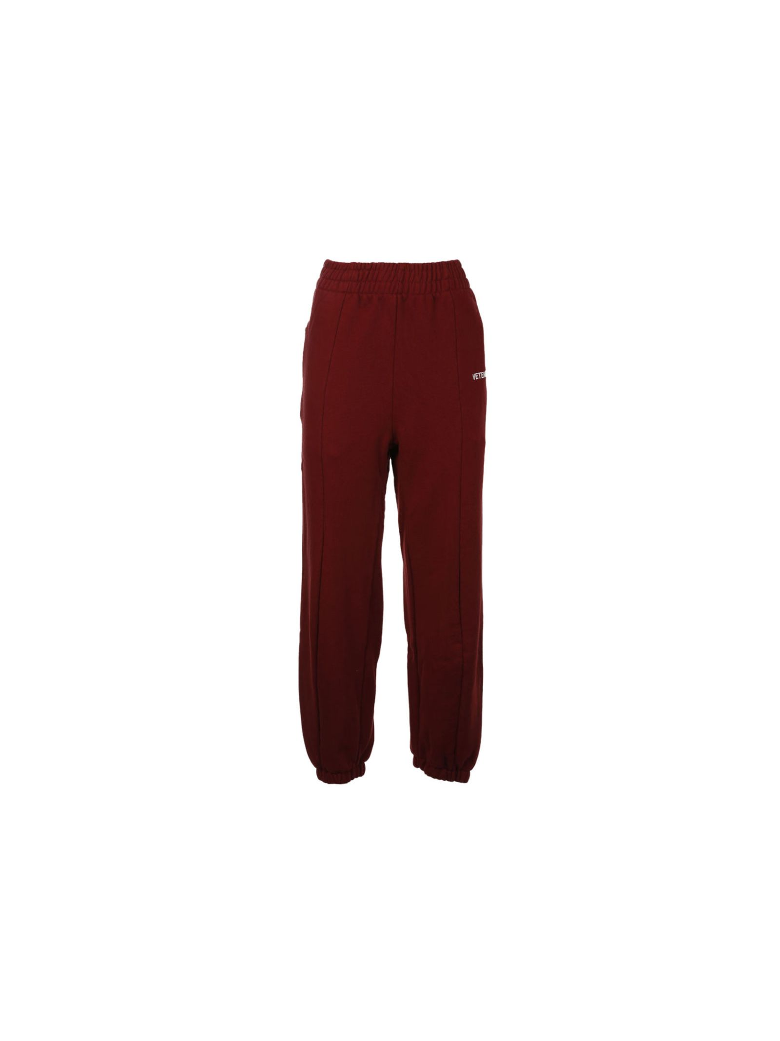 Biker Tapered Track Pants from Vetements: Burgundy Biker Tapered Track Pants with drawstring elasticated waistband, embroidered logo at front, zipped pockets at sides, closed cuffs, pulls on.