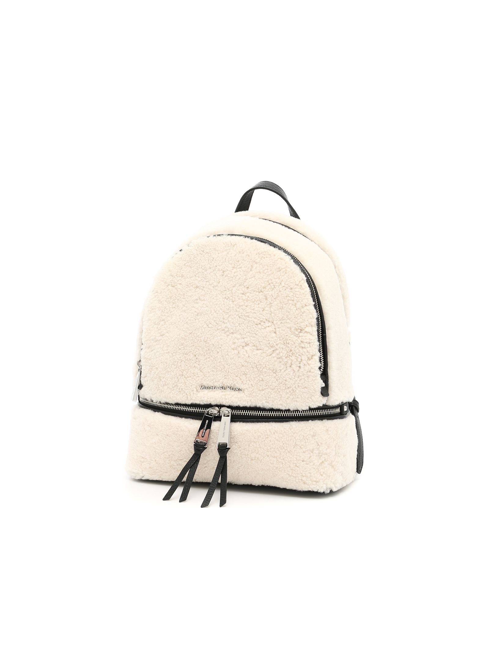 Shearling Rhea backpack with grain leather hems, adjustable shoulder straps, two compartments divided by a zip, front outer zip pocket, inside pockets, logo twill lining, front lettering logo.